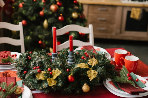 christmas-composition-with-red-candles-festive-table-with-red-tablecloth_121837-730